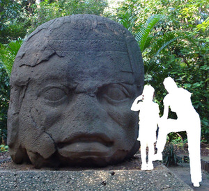Gigantic Olmec head in Mexico, reminding of the first millenniun BC. The author of the photograph uploaded in 2008 to Vikiteka was indicated as Simon Burchell. Anonymous woman and girl's figures allows a better understanding of the size proportions. Like other surviving Olmec heads this one also has negroid facial features.