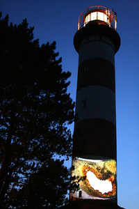 A. Maknytė's artistic act near Nida lighthouse during the photo artists' seminar.