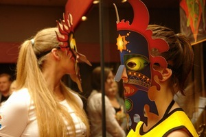 Guests were met by girls with faces covered with cardboard masks. Photo by A.Masiokaitė